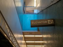 Elevator sign in a dark subway royalty free stock photos