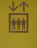 Elevator sign. In green and brown icon Royalty Free Stock Photos