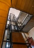 Elevator and spiral staircase in an old house in Budapest, Hungary royalty free stock photography