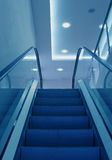 Elevator staircase. Blue light lower view royalty free stock photography
