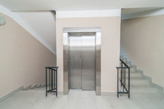 Elevator and stairs. Up and down in a modern elegant building royalty free stock images
