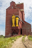 Elevator. Weathered grain elevator with peeling paint Royalty Free Stock Photos