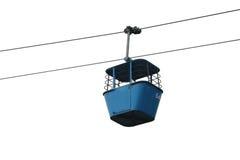 Elevatore blu isolato della gondola con i cavi Fotografie Stock