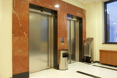 Elevators. Two elevators in luxurious interior Royalty Free Stock Photo