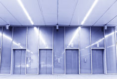 Elevators in blue Royalty Free Stock Photo
