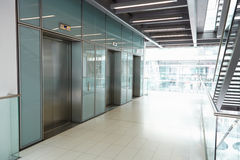 Elevators in the empty corridor of a corporate business Stock Photography