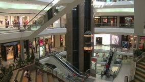 Elevators and escalators moving within mall (5 of 8). A view or scene of Shopping stock video