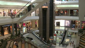 Elevators and escalators moving within mall (6 of 8). A view or scene of Shopping stock footage
