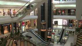 Elevators and escalators moving within mall (7 of 8). A view or scene of Shopping stock video
