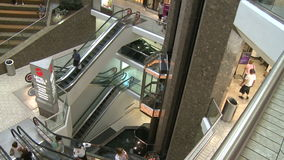 Elevators and escalators moving within mall (2 of 8). A view or scene of Shopping stock footage