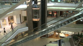 Elevators and escalators moving within mall (8 of 8). A view or scene of Shopping stock footage