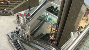 Elevators and escalators moving within mall (1 of 8). A view or scene of Shopping stock video