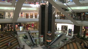 Elevators and escalators moving within mall (3 of 8). A view or scene of Shopping stock video footage