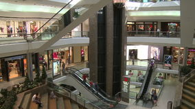Elevators and escalators moving within mall (4 of 8). A view or scene of Shopping stock footage