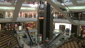 Elevators and escalators moving within Town Center (1 of 2). A view or scene of Shopping stock video