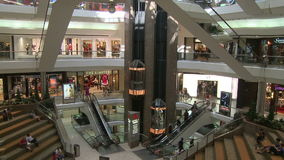 Elevators and escalators moving within Town Center (2 of 2). A view or scene of Shopping stock video