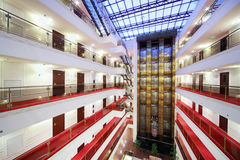 Elevators and floors with many doors in spacious hotel royalty free stock image