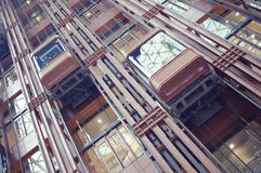 Elevators. Group of elevators in with glass cabin Royalty Free Stock Photography