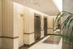 Elevators in Lobby of Modern Building. Stock Photo