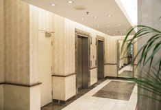 Elevators in Lobby of Modern Building. Stock Photo