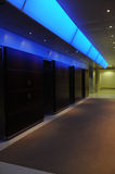 Elevators in office building with blue light accen Stock Image