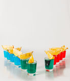 Eleven color shot drinks, red, blue and green kamikaze, quarters Royalty Free Stock Images