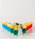 Eleven color shot drinks, red, blue and green kamikaze, quarters Stock Images