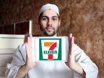 7-Eleven logo. Logo of the international chain of convenience stores 7-Eleven on samsung tablet holded by arab muslim man Royalty Free Stock Photo