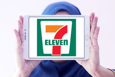 7-Eleven logo. Logo of the international chain of convenience stores 7-Eleven on samsung tablet holded by arab muslim woman Royalty Free Stock Photo