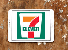 7-Eleven logo. Logo of the international chain of convenience stores 7-Eleven on samsung tablet on wooden background Stock Photos