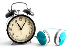 Eleven O Clock and blue headphone. In white isolated Stock Photos
