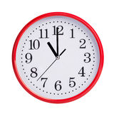 Eleven o'clock on a round dial. Eleven o'clock on a red round dial stock image