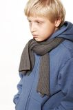 An eleven year upset boy. Backgroun is white Royalty Free Stock Photos