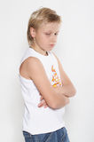 An eleven year upset boy Background is white. royalty free stock image