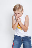 An eleven year upset boy Background is white.Photo2 royalty free stock photos