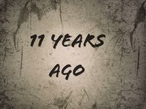 Eleven 11 years ago line on the old vintage page background. Eleven years ago line old vintage page background stock photos