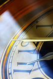 Eleventh Hour. Clock set to the eleventh hour.  Angled sunlight, with gold and blue tones Royalty Free Stock Photo