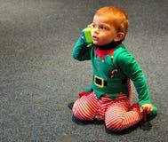 Elf calling Santa Royalty Free Stock Images