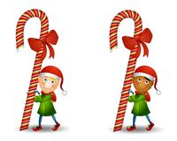 Elf Carrying Candy Cane Royalty Free Stock Photography