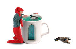 Elf catching ducks in a mug Royalty Free Stock Photos