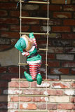 Elf climbing a latter. Santa's helper An Elf climbing a latter to the roof Stock Photography