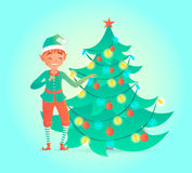 Elf decorates Christmas tree. Cute character. Royalty Free Stock Photo