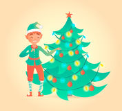 Elf decorates Christmas tree. Cute character. Stock Photo