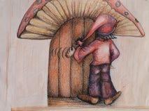 Elf, der an der zwergartigen Tür klopft Stockfotos
