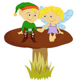 Elf and Fairy. An elf and fairy sit on a mushroom Stock Image