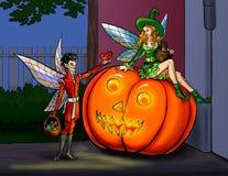 Elf or fairy make a present heart to girl on pumpkin Stock Photos