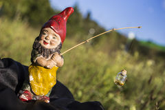 Elf find gold. How we find a gold? Call the elf and he find for you a goodness of life Stock Photography