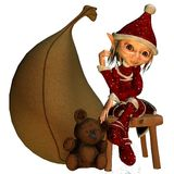Elf girl as a Christmas help Royalty Free Stock Images