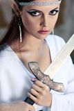 Elf girl. Close up holding the sword stock photo