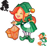 Elf girl with gingerbread castle Royalty Free Stock Photos